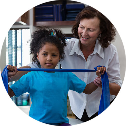 Pediatric Physical Therapist attending a child client
