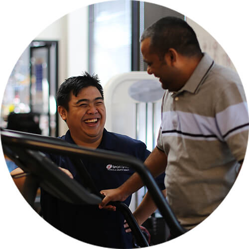 physical therapist and patient laughing