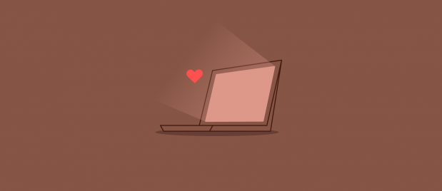 laptop open with light coming out of the screen with heart that represents love