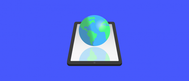 a globe of Earth hovering over a tablet