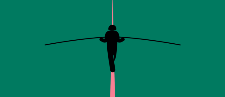 man walking a tightrope away from the viewer