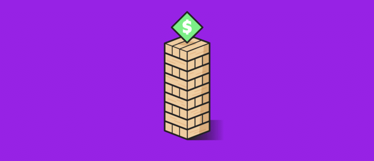 stack of Jenga blocks with a dollar sign on top